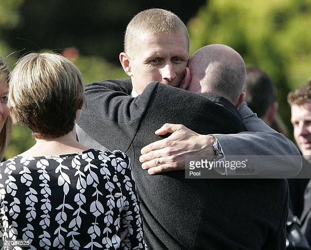 Alister McRae is hugged as he arrives for the funeral of Colin McRae and son Johnny at East arrive for the funeral of Colin McRae and son Johnny at...