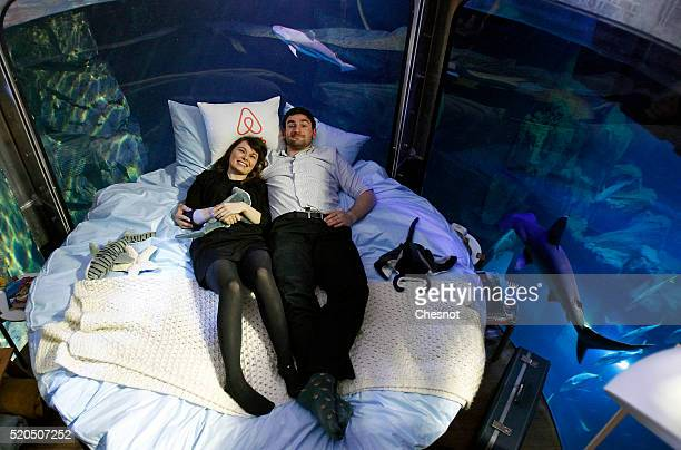 Alister Shipman from Britain and Hannah Simpson from Northern Ireland winners of a competition on the Airbnb accommodation site pose in a bed of an...