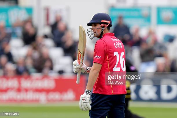 Alistiar Cook waves his bat having scored fifty runs during the Royal London OneDay Cup between Essex Eagles and Gloucestershire at Cloudfm County...