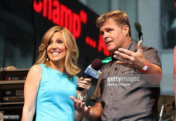 Alisyn Camerota interviews members of the band Lonestar during FOX Friends All American Concert Series outside of FOX Studios on May 31 2013 in New...