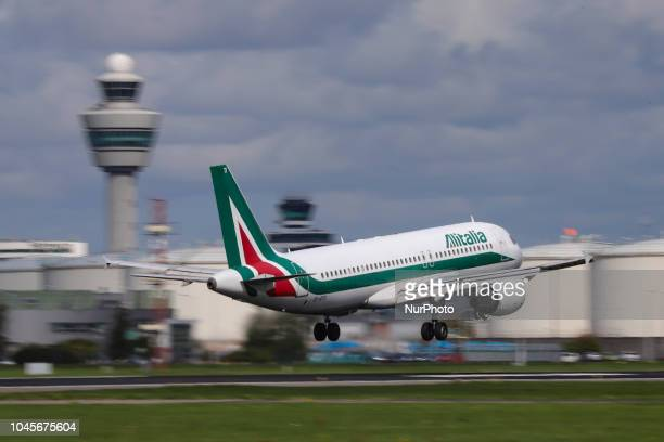 Alitalia Airbus A320200 with registration EIDTI is landing at Amsterdam Schiphol International Airport during a sunny day The airplane is named after...