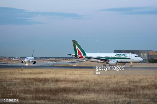 Alitalia Airbus taking off on runway 18 West