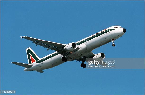 Alitalia airplane Airbus A321 flies in the sky in 2001over Rome Italy