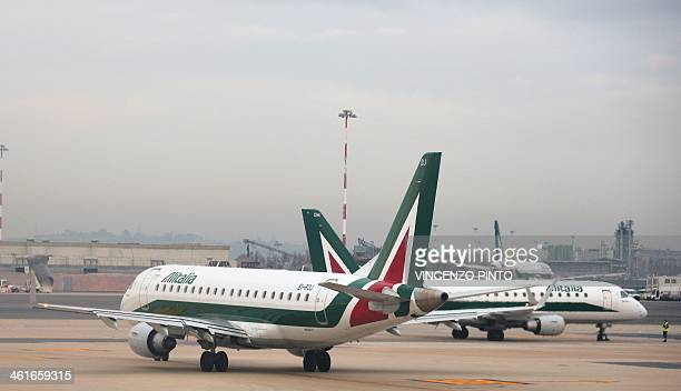 Alitalia airplanes are seen at the Fiumicino airport on January 9 2014 near Rome AFP / VINCENZO PINTO