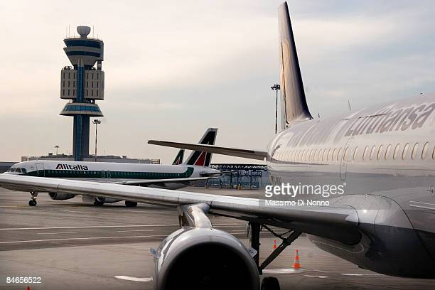 Alitalia and LufthansaItalia airplanes at Milan Malpensa Airport on February 04 2009 in Milan ItalyThis is the first time in the history of Lufthansa...