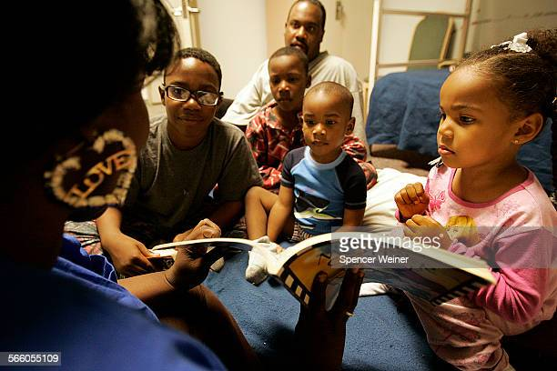 Alitha Chism left reads a bedtime story to her children at the Union Rescue Mission in downtown Los Angeles March 27 2009 Alitha and her husband...