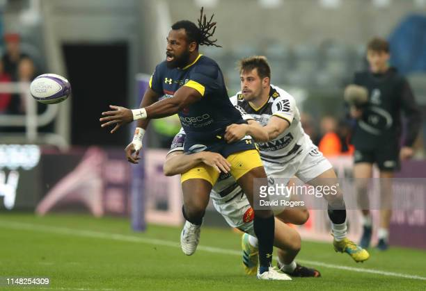 Alivereti Raka of ASM Clermont off loads the ball in a tackle during the Challenge Cup Final match between La Rochelle and ASM Clermont at St James...