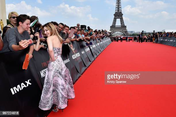 Alix Benezech poses for a selfie with a fan during the Global Premiere of 'Mission Impossible Fallout' at Palais de Chaillot on July 12 2018 in Paris...