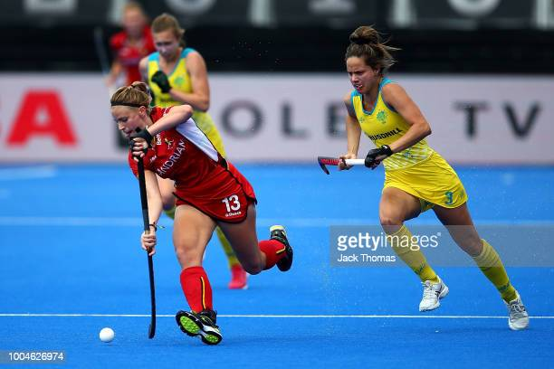Alix Gerniers of Belgium and Brooke Peris of Australia in action during the Pool D game between Australia and Belgium of the FIH Womens Hockey World...