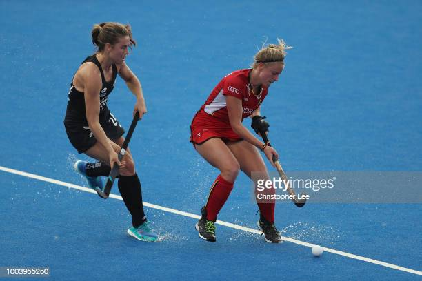 Alix Gerniers of Belgium and Rose Keddell of New Zealand in action during the Pool D game between New Zealand and Belgium of the FIH Womens Hockey...