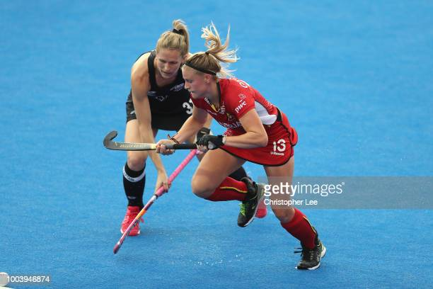 Alix Gerniers of Belgium and Stacey Michelsen of New Zealand race for the ball during the Pool D game between New Zealand and Belgium of the FIH...