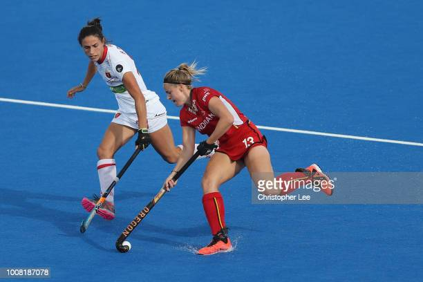 Alix Gerniers of Belgium battles with Beatriz Perez of Spain during the Crossover game between Belgium and Spain of the FIH Womens Hockey World Cup...