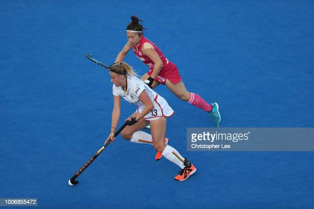 Alix Gerniers of Belgium battles with Hazuki Nagai of Japan during the Pool D game between Japan and Belgium of the FIH Womens Hockey World Cup at...