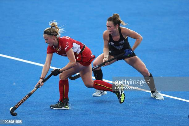 Alix Gerniers of Belgium battles with Kelsey Smith of New Zealand during the Pool D game between New Zealand and Belgium of the FIH Womens Hockey...