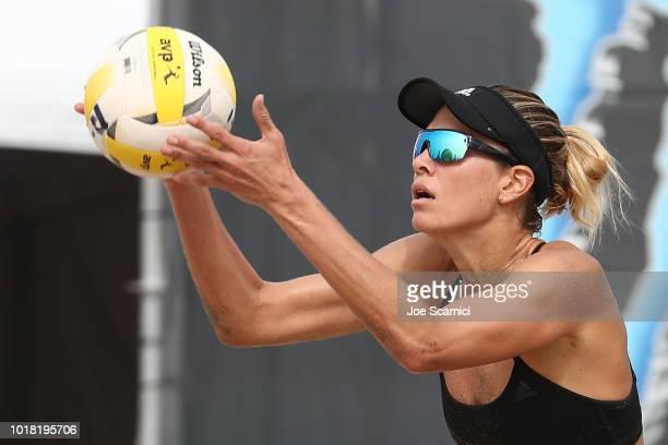 Alix Klineman serves the ball during her round of 32 match against Annika and Teegan Van Gunst AVP Manhattan Beach Open on August 17 2018 in...