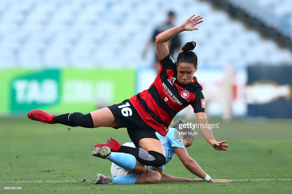 Alix Roberts of the Wanderers and Tyla Jay Vlajnic of Melbourne City compete for the ball during the round nine W-League match between the Western Sydney Wanderers and Melbourne City at ANZ Stadium on January 1, 2018 in Sydney, Australia.