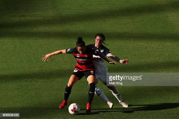 Alix Roberts of the Wanderers is challenged by Melina Ayres of the Victory during the round 12 WLeague match between the Western Sydney Wanderers and...