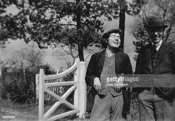 Alix Strachey shares a joke with Harry Norton at Ham Spray in Wiltshire home of Lytton Strachey and Dora Carrington
