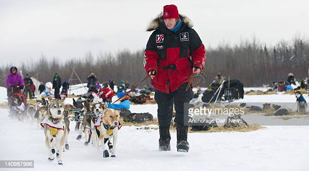 Aliy Zirkle leads her dogs from the Nikolai checkpoint in Alaska during the Iditarod Trail Sled Dog Race on Tuesday March 6 2012