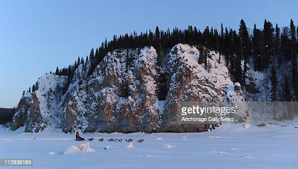 Aliy Zirkle passes in front of the cliffs just outside of the Yukon River checkpoint in Ruby Alaska during the 2010 Iditarod Sled Dog Race on Friday...