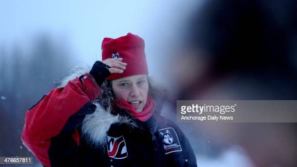 Aliy Zirkle talks about the snowless trail across the Farewell Burn at the Nikolai checkpoint during the 2014 Iditarod Trail Sled Dog Race on Tuesday...