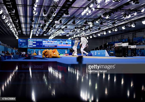 Aliya Itzkowitz of Great Britain and Martyna Watora of Poland compete in the Women's Fencing Individual Sabre round of 32 match during day thirteen...
