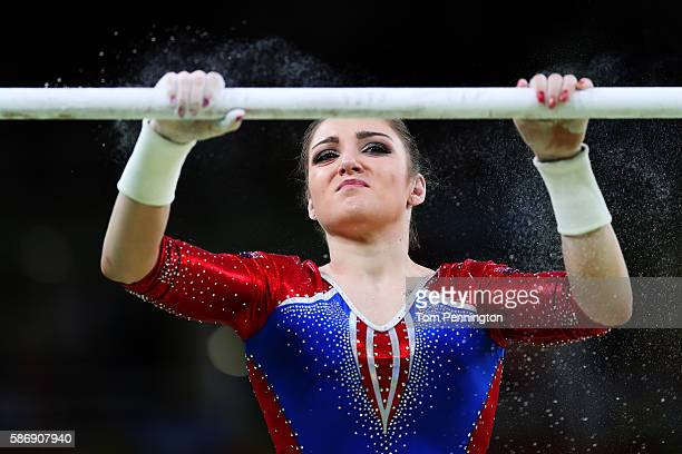 Aliya Mustafina of Russia applies chalk before competing in the uneven bars during Women's qualification for Artistic Gymnastics on Day 2 of the Rio...