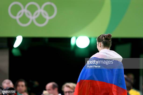 Aliya Mustafina of Russia celebrate winning the gold medal after the Women's Uneven Bars Final on Day 9 of the Rio 2016 Olympic Games at the Rio...