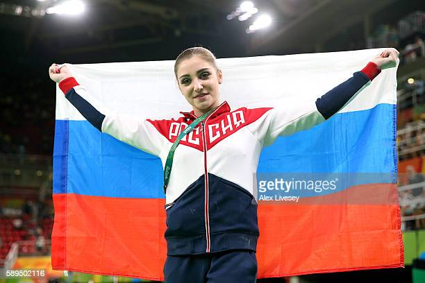 Aliya Mustafina of Russia celebrates winning the gold medal after the Women's Uneven Bars Final on Day 9 of the Rio 2016 Olympic Games at the Rio...