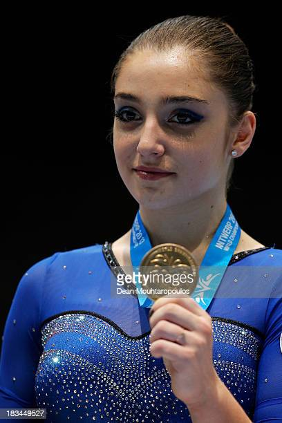 Aliya Mustafina of Russia poses after winning the Gold medal in the Women's balance beam final on Day Seven of the Artistic Gymnastics World...