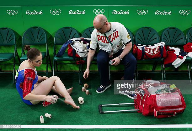 Aliya Mustafina of Russia treats her heel during Women's qualification for Artistic Gymnastics on Day 2 of the Rio 2016 Olympic Games at the Rio...