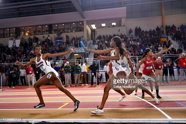 Aliyah Abrams of South Carolina hands the baton to Tatyana Mills during the women's 4X400 relay during the Division I Mens and Womens Indoor Track...