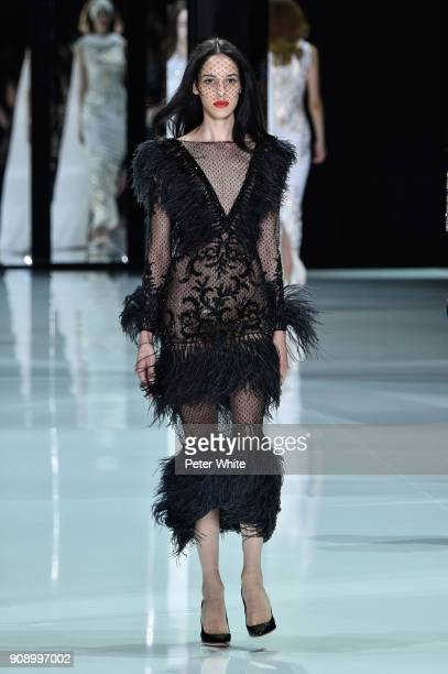 Aliyah Morgan walks the runway during the Ralph Russo Spring Summer 2018 show as part of Paris Fashion Week on January 22 2018 in Paris France