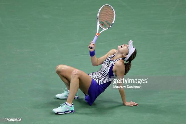 Alizé Cornet of France reacts after missing a return during her Women's Singles third round match against Madison Keys of the United States on Day...