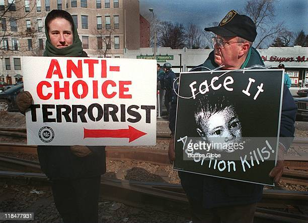 Aliza of WAC and John Cronin with Operation Rescue outside clinic at 1031 Beacon Street on March 11, 1994 in Brookline, Massachusetts.