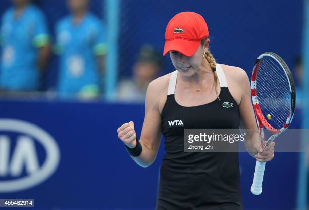 Alize Conrnet of France reacts during her match against Yulia Putintseva of Kazakhstan during day one of the 2014 WTA Guangzhou Open at Taint Sports...