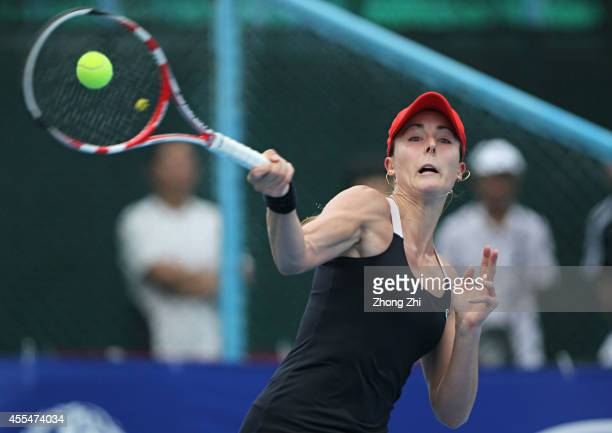 Alize Conrnet of France returns a shot during her match against Yulia Putintseva of Kazakhstan during day one of the 2014 WTA Guangzhou Open at Taint...