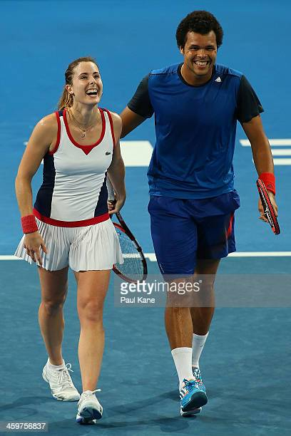 Alize Cornet and JoWilfried Tsonga of France celebrate defeating Petra Kvitova and Radek Stepanek of the Czech Republic in the mixed doubles match...