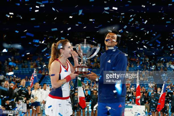 Alize Cornet and JoWilfried Tsonga of France hold the Hopman Cup after defeating Grzegorz Panfil and Agnieszka Radwanska of Poland in the mixed...