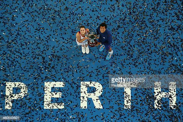 Alize Cornet and JoWilfried Tsonga of France pose with the Hopman Cup trophy after defeating Agnieszka Radwanska and Grzegorz Panfil of Poland in the...