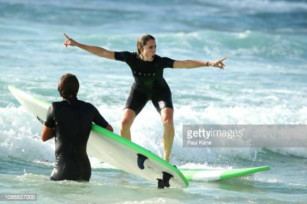 Alize Cornet and Lucas Pouille of France attend a surfing lesson at Trigg Beach during day four of the 2019 Hopman Cup at RAC Arena on January 01,...