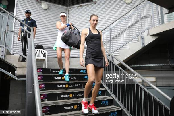 Alize Cornet of France and Petra Martic of Croatia head out on court for their second match during day three of the 2020 Women's ASB Classic at ASB...