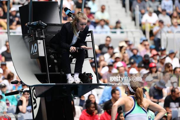 Alize Cornet of France argues with chair umpire Miriam Bley during her Women's Singles second round match against Donna Vekic of Croatia on day four...