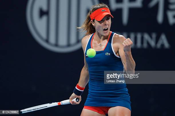 Alize Cornet of France celebrates a point against Dominika Cibulkova of Slovakia during the Women's singles second round match on day four of the...