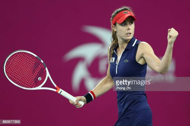 Alize Cornet of France celebrates a point during the match against Yanina Wickmayer of Belgium on Day 4 of WTA Guangzhou Open on September 21 2017 in...