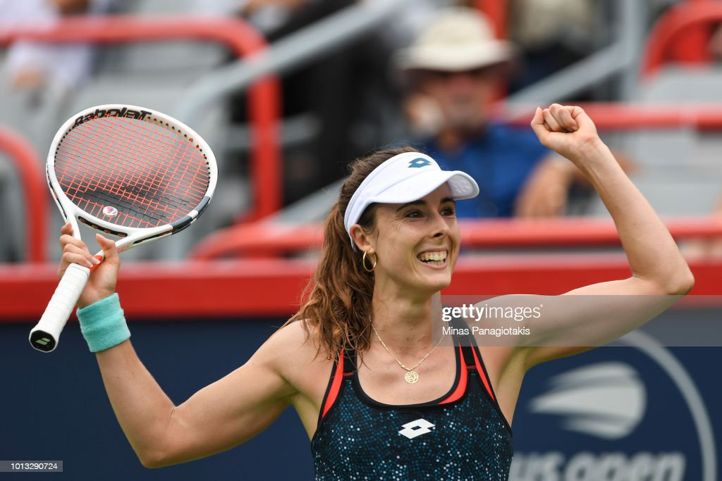 Alize Cornet of France celebrates after defeating Angelique Kerber of Germany 6-4, 6-1 during day three of the Rogers Cup at IGA Stadium on August 8, 2018 in Montreal, Quebec, Canada.