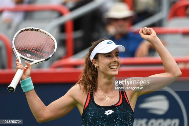 Alize Cornet of France celebrates after defeating Angelique Kerber of Germany 64 61 during day three of the Rogers Cup at IGA Stadium on August 8...