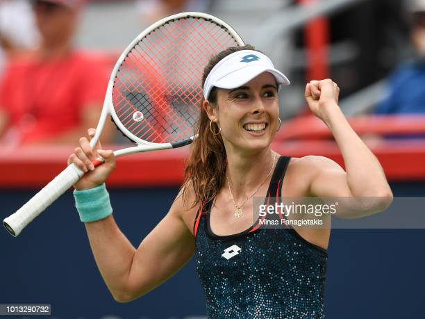 Alize Cornet of France celebrates after defeating Angelique Kerber of Germany 6-4, 6-1 during day three of the Rogers Cup at IGA Stadium on August 8,...