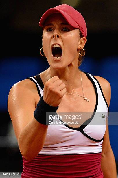 Alize Cornet of France celebrates after her victory against Annika Beck of Germany during day one of the WTA Porsche Tennis Grand Prix at Porsche...