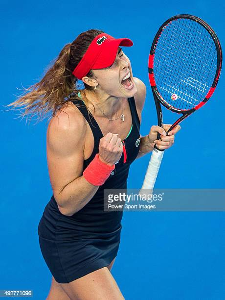 Alize Cornet of France celebrates after wining the point against Yaroslava Shvedova of Kazakhstan during the WTA Prudential Hong Kong Tennis Open on...